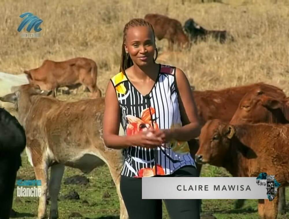 Livestock Wealth Founder Shezi on farm talking with Carte Blanche Claire Mawisa